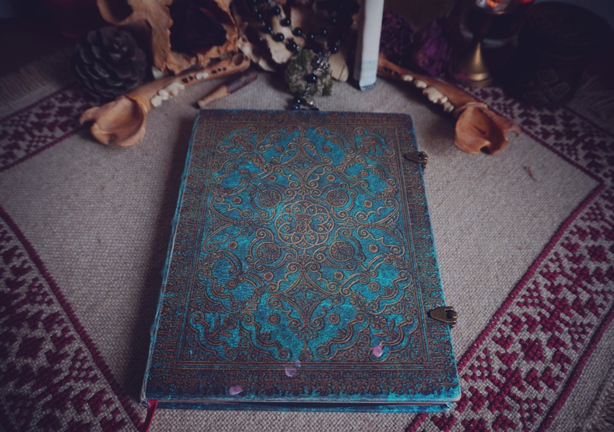 Magickal diary on Romanian carpet with pattern