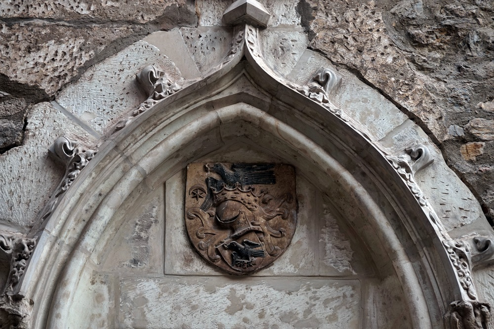 Coat of Arms of the Hunyadi Family showing Raven. Corvin Castle. Photo by Radiana Pit.