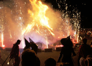 Walpurgisnacht in modern day Erfurt, Germany. Festival with masked persons around fire.
