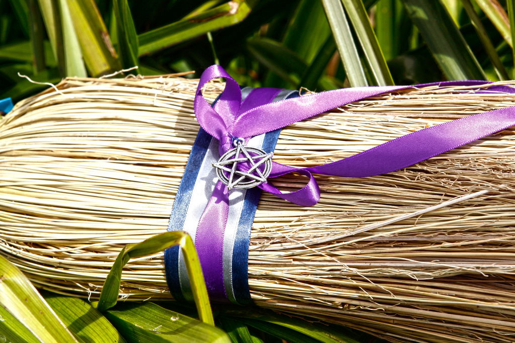 Magic witch's broom - decorated with pentagram and colored ribbons. Wicca broom / besom for witchcraft and sabbath.