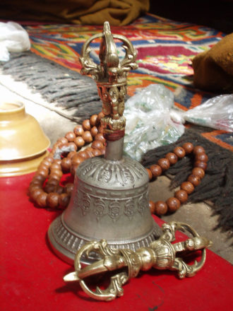 Vajra and bell and mala (prayer bead) - tantric buddhist ritual items.