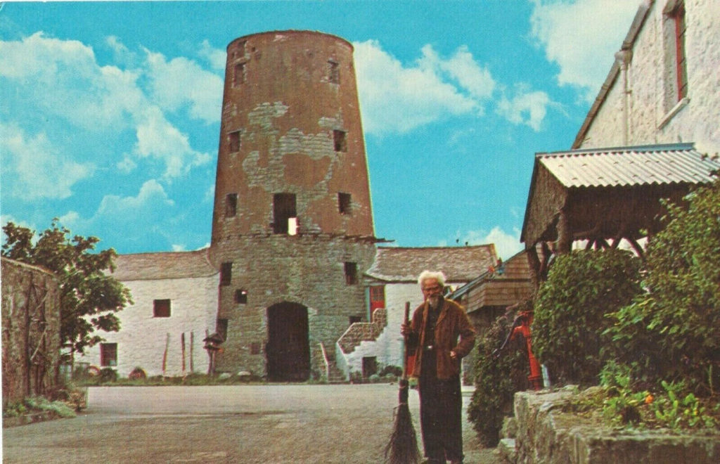 Gerald Gardner standing before the first Museum »The witches Mill« on the Isle of Man